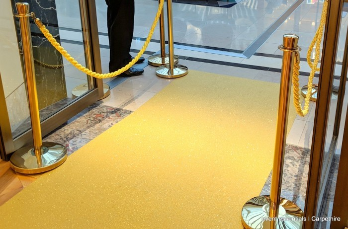 Brass bollards with gold rope
