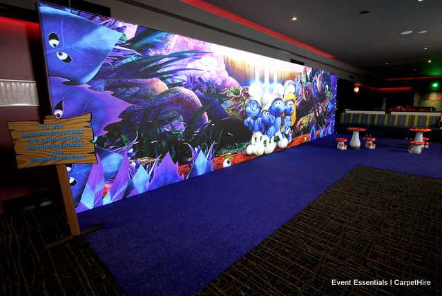 Internally lit 9-metre-wide media wall, blue astro turf and custom theming