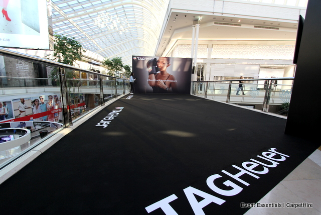 Two media walls, black carpet and decal branding
